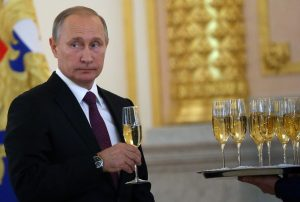 Russian President Vladimir Putin takes a glass of champagne during the reception for new foreign ambassadors at Grand Kremlin Palace on November 9, 2016 in Moscow, Russia. Putin has received credentials from 19 new foreign ambassadors and also extended congratulates to Donald Trump the winner of U.S. Presidential election today.